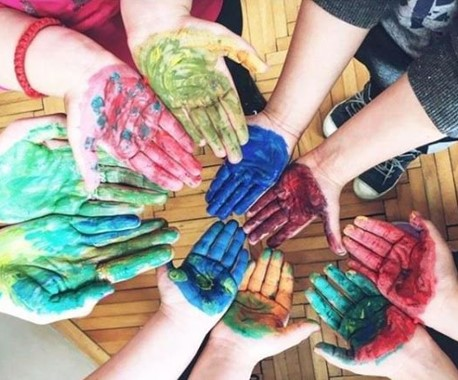 hands with coloured paint